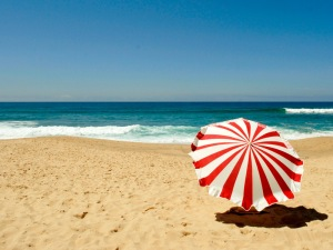 Red umbrella on the beach in summer